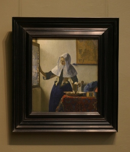 Johannes Vermeer's Young Woman with a Water Pitcher with frame
