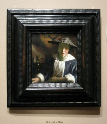 Girl with a Flute by Johannes Vermeer in its frame