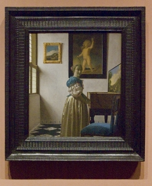 Johannes Vermeer's A Lady Standing at a Virginal with frame
