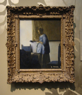 Johannes Vermeer's Woman in Blue Reading a Letter with frame