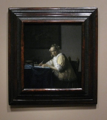 Johannes Vermeer's A Lady Writing with frame