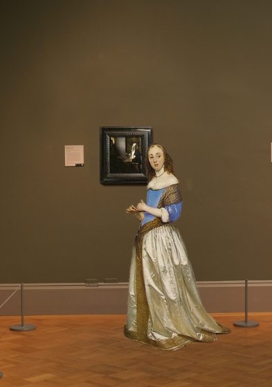 Johannes Vermeer's Woman Holding a Balance in scale
