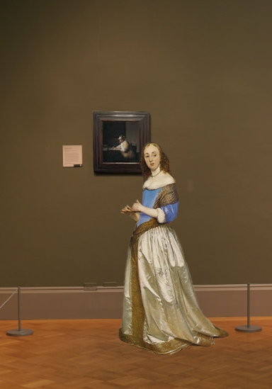 Johannes Vermeer's A Lady Writing in scale