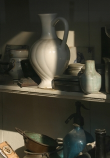 The play of light on a Delft antique shop window