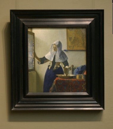 vermeers paintings in their frames young woman with a